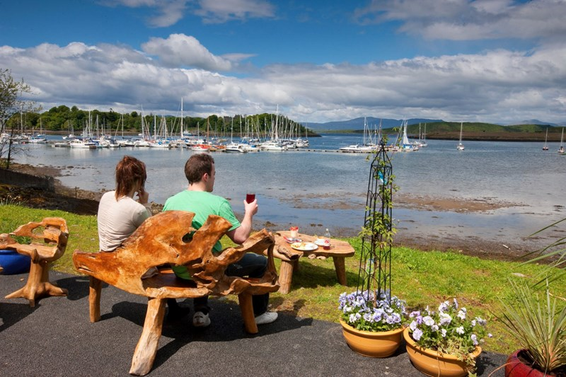 Outside view from Poppies Garden Centre towards Dunstaffnage Castle and Marina