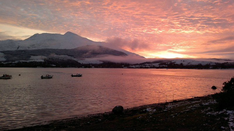 Taynuilt Boat Club's boat in the sunrise on Loch Etive with Ben Cruachan in the background