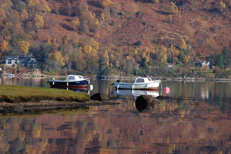 A couple of Taynuilt Boat Club's boats on a flat calm Loch Etive