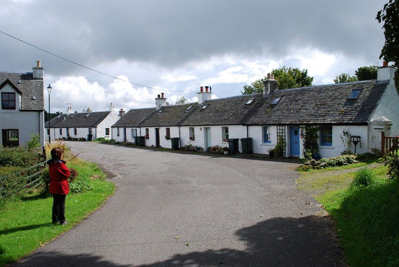 White cottages on Luing on a bright sunny day